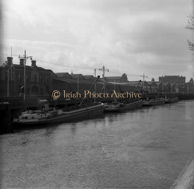 05/03/1957<br /> Scenes on the Liffey River, Dublin at Guinness's Wharf, the Guinness barges tied up outside the brewery with Houston Statin in the far background.