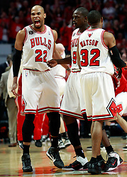 15.05.2011, UNITED CENTER, CHICAGO, USA, NBA, Chicago Bulls vs Miami Heat, im Bild Taj Gibson (L) reacts with Chicago Bulls forward Luol Deng (C) against Miami Heat in game 1 of the NBA Eastern Conference Championships at the United Center in Chicago, EXPA Pictures © 2011, PhotoCredit: EXPA/ Newspix/ KAMIL KRZACZYNSKI +++++ ATTENTION - FOR AUSTRIA/ AUT, SLOVENIA/ SLO, SERBIA/ SRB an CROATIA/ CRO, SWISS/ SUI and SWEDEN/ SWE CLIENT ONLY +++++