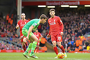 Liverpool midfielder Adam Lallana  lays the ball off during the Barclays Premier League match between Liverpool and Sunderland at Anfield, Liverpool, England on 6 February 2016. Photo by Simon Davies.