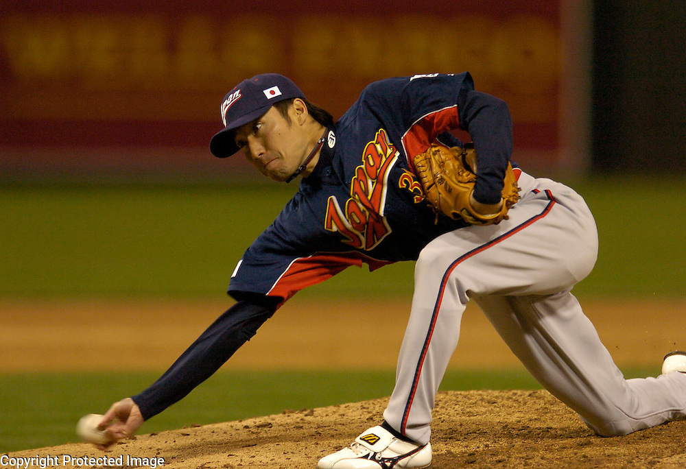 Team Japan's Shunsuke Watanabe throws a pitch in the 5th inning against Team Cuba in Final action of the World Baseball Classic at PETCO Park, San Diego, CA.