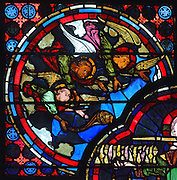 Three angels representing 3 of the 7 bishops of Asia Minor, from the stained glass window of the Apocalypse, 1215-25, in bay 14, in the ambulatory of Bourges Cathedral or the Cathedrale Saint-Etienne de Bourges, built 1195-1230 in French Gothic style and consecrated in 1324, in Bourges, Centre-Val de Loire, France. 22 of the original 25 medieval stained glass windows of the ambulatory have survived. The cathedral is listed as a UNESCO World Heritage Site. Picture by Manuel Cohen