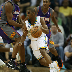 Chris Paul dribbles around defenders for the New Orleans Hornets against the Phoenix Suns on February 26, 2008 at the New Orleans Arena in New Orleans, Louisiana. The New Orleans Hornets defeated the Phoenix Suns 120-103.