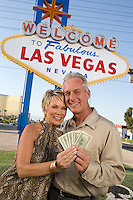 Middle-aged couple in front of Welcome to Las Vegas sign, portrait