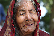 August 2016 Keranigonj, Bangladesh ~ Mamata Begum 85, react after she lost his house by recent flood, she said nobody look after her during my last age, and my only living house is also break down by river erosion, now I am helpless and homeless at LAKHIR CHAR in Keranigonj, Dhaka Bangladesh, on 19 August, 2016. According to the media report the monsoon rain in the country's northern region as well as in the Indian bordering state like Assam has been low, and the weather is likely to remain unchanged monsoon season. So there is no change for deterioration in the overall flood situation in Bangladesh.