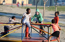 Cape Town- 180830  Siphosethu Tyongozi from kuyasa Khayelitsha playing with other kids on the street. The family are living with albinism. Albinism is a genetic condition. Primarily, albinism affects the hair eyes skin and vision The most common cause of albinism is an interruption in the functioning of the enzyme tyrosinase Picture:Ayanda Ndamane/ African News Agency ANA