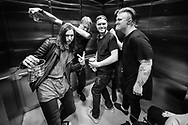Spencer Chamberlain, Chris Dudley, and Aaron Gillespie of Underoath take the elevator to the stage with friends on April 24, 2016 at Hard Rock Live in Orlando, Florida