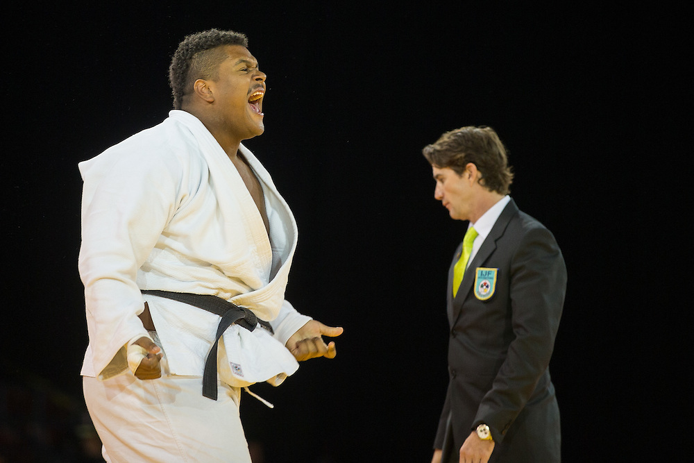 Freddy Figueroa of Ecuador celebrates his win over Alex Garcia of Cuba in their men's judo +100kg class final of the table at the 2015 Pan American Games in Toronto, Canada, July 14,  2015.  AFP PHOTO/GEOFF ROBINS