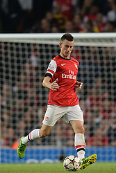 LONDON, ENGLAND - Oct 01: Arsenal's defender Laurent Koscielny from France during the UEFA Champions League match between Arsenal from England and Napoli from Italy played at The Emirates Stadium, on October 01, 2013 in London, England. (Photo by Mitchell Gunn/ESPA)