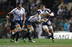 CAPE TOWN, SOUTH AFRICA - 11 JUNE 2011, Stormers wing Bryan Habana attempts to break Bulls captain Victor Matfield tackle during the Super Rugby match between DHL Stormers and the Bulls held at DHL Newlands Stadium in Cape Town, South Africa..Photo by Shaun Roy / Sportzpics.net