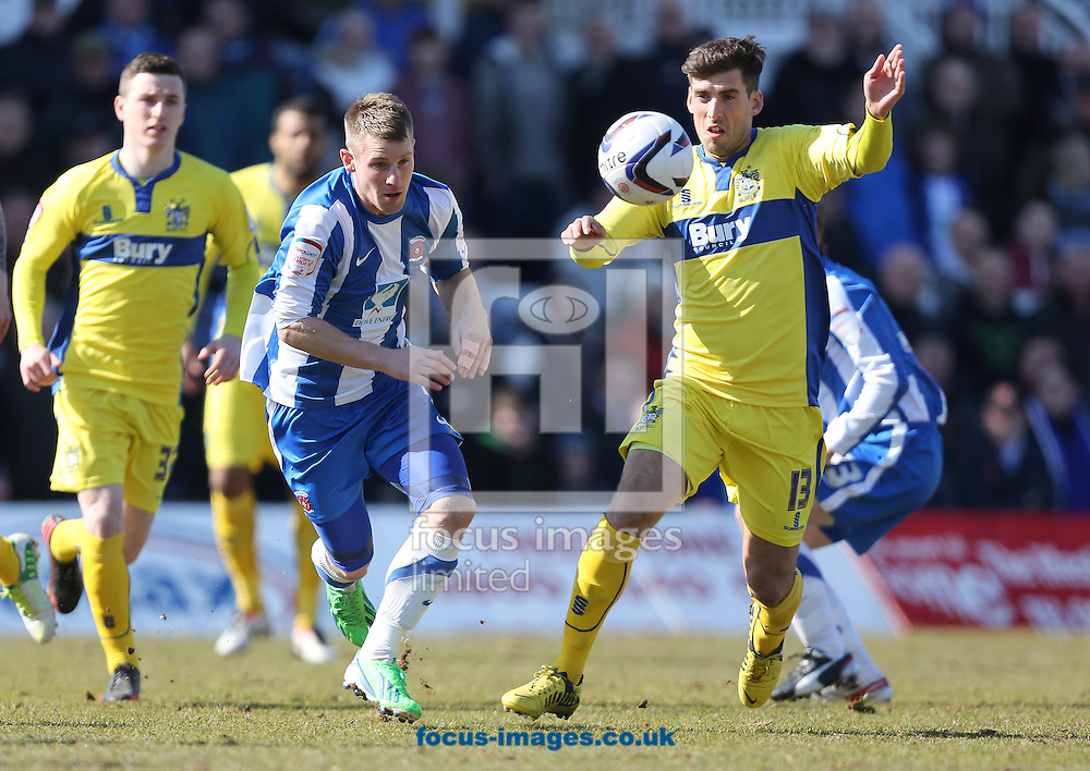 Picture by Paul Gaythorpe/Focus Images Ltd +447771 871632.06/04/2013.Jonathan Franks of Hartlepool United and Mark Carrington of Bury during the npower League 1 match at Victoria Park, Hartlepool.