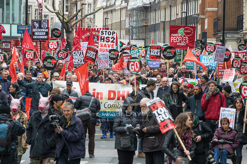 """London, April 16th 2016. Protesters march along Gower Street as thousands of people supported by trade unions and other rights organisations demonstrate against the policies of the Tory government, including austerity and perceived favouring of """"the rich"""" over """"the poor""""."""