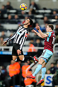 Mikel Merino (#23) of Newcastle United stretches to try to head the ball ahead of Ashley Barnes (#10) of Burnley during the Premier League match between Newcastle United and Burnley at St. James's Park, Newcastle, England on 31 January 2018. Photo by Craig Doyle.