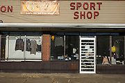Vandalized storefront of a now closed sports shop that sold Clairton Bears branded merchandise. Against the odds, over twenty percent of the city's families exist at the poverty level — nearly three times the state rate and more than double the national average, and the city has no grocery store, the Bears' 66-game winning streak that ended in 2012 is the longest ever in Pennsylvania high school history.