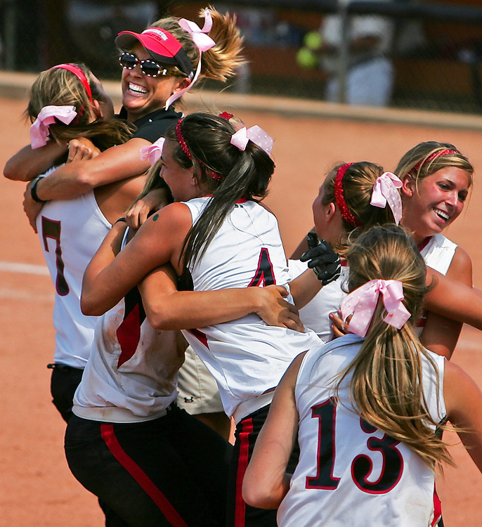 Xavier Mascareñas/Austin American-Statesman; Huntington Devilettes head coach Ruth Wright, top left, celebrates winning Texas' Class 3A high school softball championship game with her team on May 31, 2008. The Devilettes beat the Texarkana Liberty-Eylau Leopards 1-0 at the University of Texas' McCombs Field.