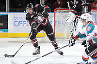 KELOWNA, CANADA - FEBRUARY 18: Cody Thiel #5 of the Red Deer Rebels makes a pass as the Red Deer Rebels visit the Kelowna Rockets on February 18, 2012 at Prospera Place in Kelowna, British Columbia, Canada (Photo by Marissa Baecker/Shoot the Breeze) *** Local Caption ***