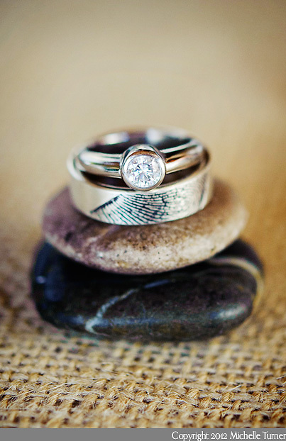 Wedding rings that have been engraved with the thumbrints of the couple.  Image by Puerto Vallarta Wedding Photographer Michelle Turner.