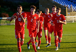 BANGOR, WALES - Monday, October 15, 2018: Wales' Brennan Johnson (L) celebrates scoring the first goal with team-mates Neco Williams, Dylan Levitt, Morgan Boyes, Jack Vale during the UEFA Under-19 International Friendly match between Wales and Poland at the VSM Bangor Stadium. (Pic by Paul Greenwood/Propaganda)