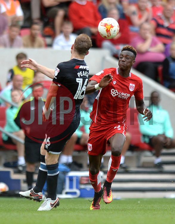 Tammy Abraham of Bristol City challenges for the ball with Alex Pearce of Derby County - Mandatory by-line: Dougie Allward/JMP - 17/09/2016 - FOOTBALL - Ashton Gate Stadium - Bristol, England - Bristol City v Derby County - Sky Bet Championship
