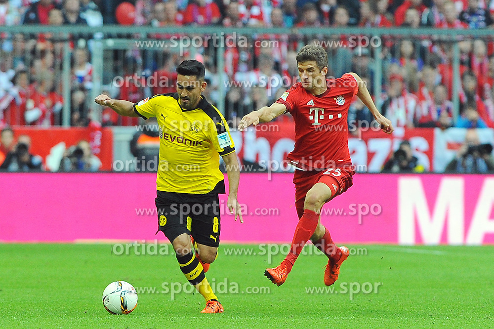 04.10.2015, Allianz Arena, Muenchen, GER, 1. FBL, FC Bayern Muenchen vs Borussia Dortmund, 8. Runde, im Bild vl. Ilkay Guendogan (Borussia Dortmund #8) verfolgt von Thomas Mueller (FC Bayern Muenchen) // during the German Bundesliga 8th round match between FC Bayern Munich and Borussia Dortmund at the Allianz Arena in Muenchen, Germany on 2015/10/04. EXPA Pictures &copy; 2015, PhotoCredit: EXPA/ Eibner-Pressefoto/ Stuetzle<br /> <br /> *****ATTENTION - OUT of GER*****
