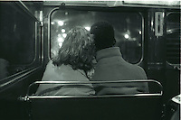 Mixed-race couple on a London bus.