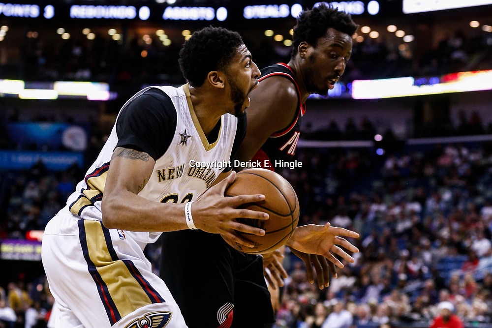 Mar 14, 2017; New Orleans, LA, USA; New Orleans Pelicans forward Anthony Davis (23) drives past Portland Trail Blazers forward Al-Farouq Aminu (8) during the first quarter of a game at the Smoothie King Center. Mandatory Credit: Derick E. Hingle-USA TODAY Sports