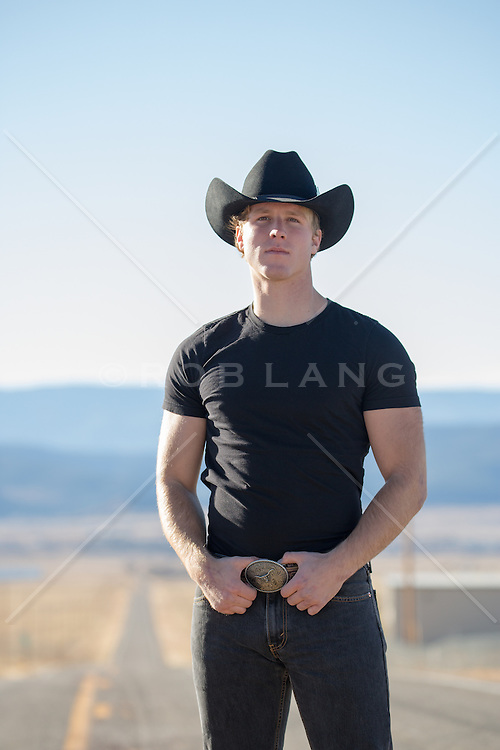 cowboy on a road overlooking mountains