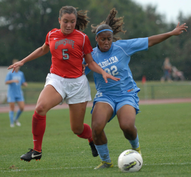 University of North Carolina defender Meg Morris (32) battles Ohio State midfielder Ellyn Gruber (5) as OSU takes on UNC in the first half of an NCAA women's college soccer game in Columbus, Ohio on Sunday, Sept. 4, 2011, at Jesse Owens Memorial Stadium.
