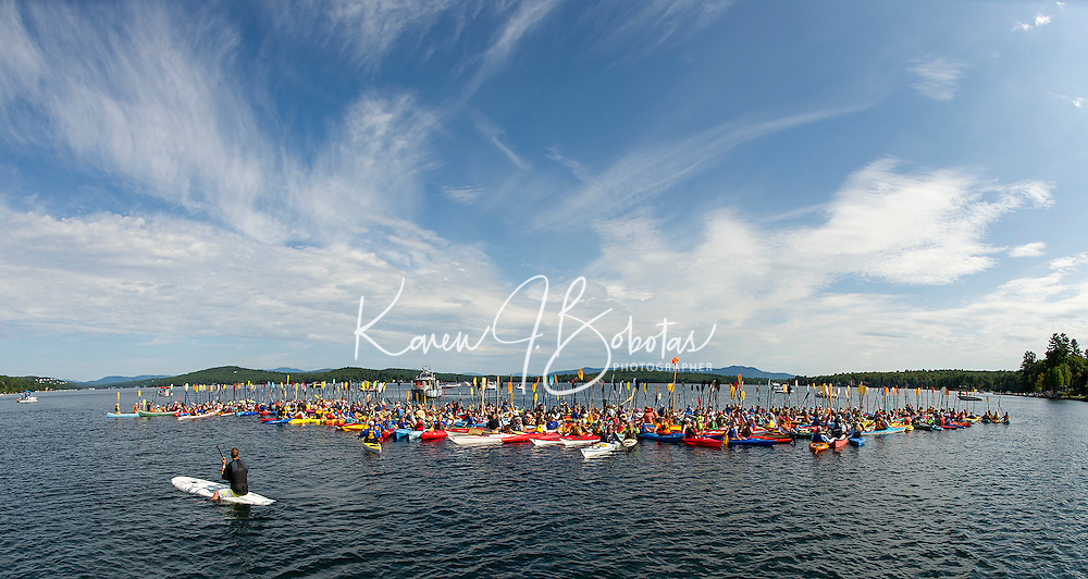 Kayaks and canoes successfully join together during Lake Fest in their attempt to break the Guinness World Record Saturday morning in Lake Winnipesaukee off Weirs Beach.  (Karen Bobotas/for the Laconia Daily Sun)