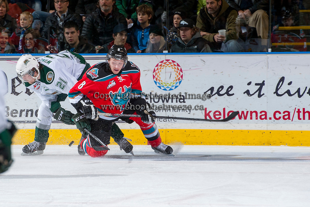 KELOWNA, CANADA - DECEMBER 6: Colten Martin #8 of the Kelowna Rockets is checked to the ice by Joshua Winquist #21 of the Everett Silvertips on December 6, 2013 at Prospera Place in Kelowna, British Columbia, Canada.   (Photo by Marissa Baecker/Shoot the Breeze)  ***  Local Caption  ***