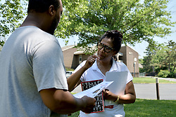 Resident Terrin Walker talks to Tanzie Youngblood as the candidate is canvassing ahead of the June 5 Primaries, at a Brigdeton, NJ low-income housing project, on May 26, 2018.