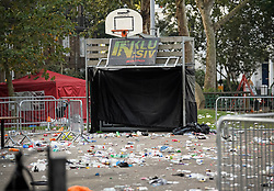 © Licensed to London News Pictures. 27/08/2019. London, UK. Rubbish and debris remains strewn around a public park in Notting Hill, west London, in the aftermath of the 2019 Notting Hill carnival. The two day event is the second largest street festival in the world after the Rio Carnival in Brazil, attracting over 1 million people to the streets of West London. Photo credit: Ben Cawthra/LNP