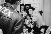 Girls at a merchandise stall inside a gig, UK, 1980s.