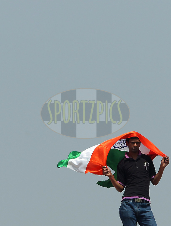 an Indian fan takes shade under his flag during day 3 of the 4th Test Match between India and Australia held at the Feroz Shah Kotla stadium in Delhi on the 24th March 2013..Photo by Ron Gaunt/BCCI/SPORTZPICS ..Use of this image is subject to the terms and conditions as outlined by the BCCI. These terms can be found by following this link:..http://www.sportzpics.co.za/image/I0000SoRagM2cIEc