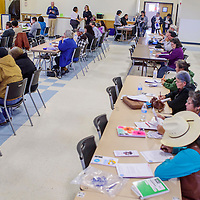Attendees take notes during a credit seminar at the Community Service Center in Gallup Thursday.
