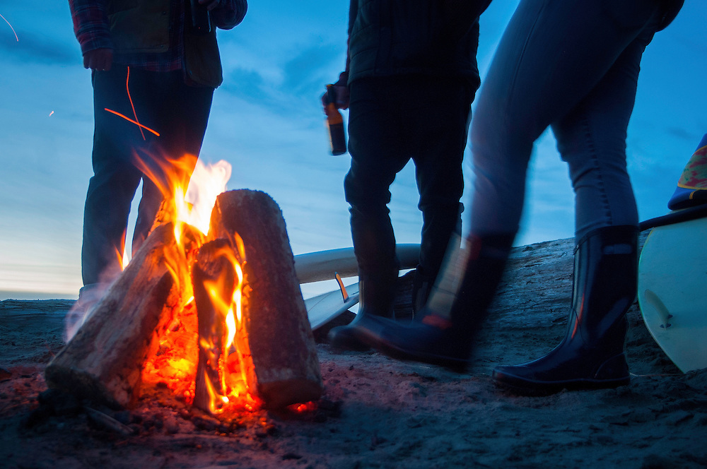 Post-surf session campfire on Chesterman Beach in Tofino, British Columbia.