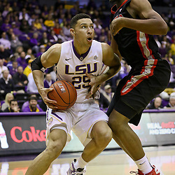 Jan 26, 2016; Baton Rouge, LA, USA; LSU Tigers forward Ben Simmons (25) drives past Georgia Bulldogs forward Yante Maten (1) during the first half of a game at the Pete Maravich Assembly Center. Mandatory Credit: Derick E. Hingle-USA TODAY Sports