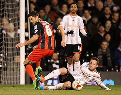 Fulham's Ross McCormack tackles Bournemouth's Andrew Surman - Photo mandatory by-line: Robbie Stephenson/JMP - Mobile: 07966 386802 - 06/03/2015 - SPORT - Football - Fulham - Craven Cottage - Fulham v AFC Bournemouth - Sky Bet Championship
