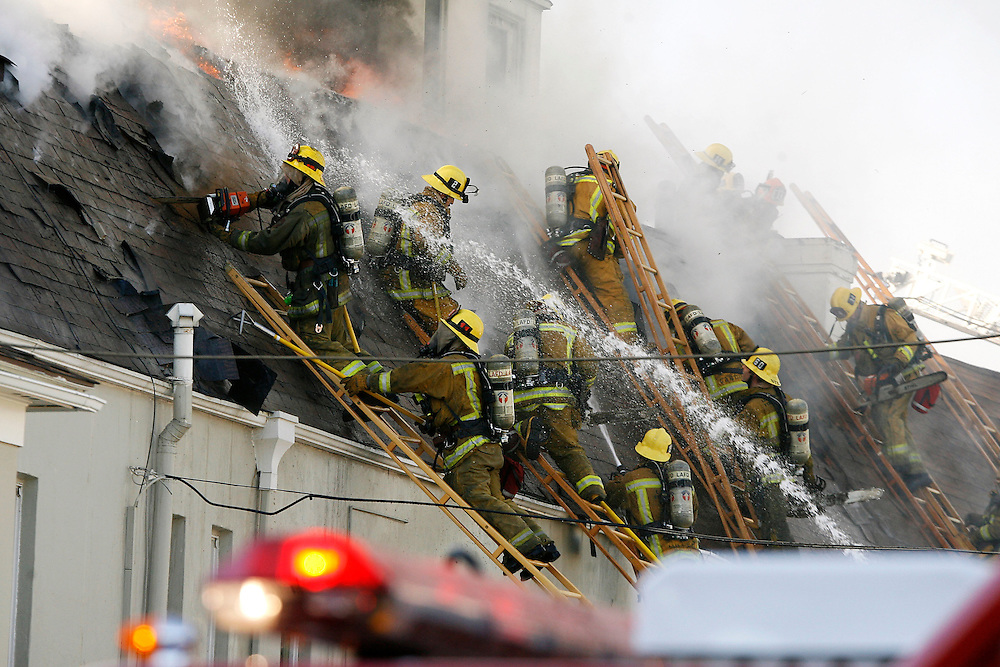 Dozens of firefighters battle a blazing fire in a three-story apartment structure in the Miracle Mile region of Los Angeles, Calif., on Tuesday, Jan., 15, 2007. Los Angeles Fire Department spokeswoman d'Lisa Davies said residents were evacuated from the building and that there were no reports of injuries.