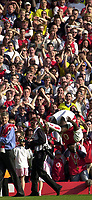 Foto: Peter Spurrier, Digitalsport<br /> NORWAY ONLY<br /> <br /> 15/05/2004  - 2003/04 Premiership Football - Arsenal v Leicester City<br /> <br /> Kolo Toure somersaults in front of the crowd