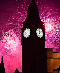 © Licensed to London News Pictures. 01/01/2017. London, UK. A fireworks display lights up the skyline behind Big Ben and the Houses of Parliament just after midnight on January 1, 2017 in London, England, to mark the start of 2017.. Photo credit: Ben Cawthra/LNP