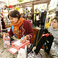 Thomas Wells | BUY AT PHOTOS.DJOURNAL.COM<br /> Teresa Irwin, right, is reflected in the mirror as The Main Attraction store owner Barbara Fleishhacker helps check out Irwin as she finishes up a few last minute Christmas gifts.
