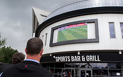 Fans watch England vs Wales on screens outside the Sports Bar and Grill at Ashton Gate - Mandatory by-line: Robbie Stephenson/JMP - 16/06/2016 - FOOTBALL - Ashton Gate - Bristol, United Kingdom  - England vs Wales - UEFA Euro 2016