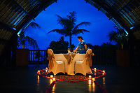 A staff member prepares a romantic candlelight dinner at the Holiday Inn Resort Benoa in Bali, Indonesia.