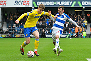 Jack Clarke (47) of Leeds United on the attack battles for possession with Josh Scowen (11) of Queens Park Rangers during the The FA Cup 3rd round match between Queens Park Rangers and Leeds United at the Loftus Road Stadium, London, England on 6 January 2019.