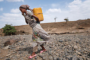Taymen, Ethiopia - 17.05.16  - Deaf Grade 8 student Meseret Memre, 16, fetches water from a nearly dry river bed in Taymen ward in the district of East Belessa, Ethiopia on May 17, 2016. CBM funds a school feeding program at Taymen primary school. Photo by Daniel Hayduk