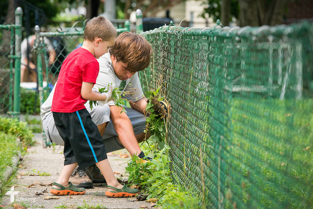Knox DeGroot helps Robert Mencik in the 2014 Youth Corps pilot project clean the grounds at Shepherd of the City Lutheran Church on Wednesday, August 13, 2014, in Philadelphia, Pa. LCMS Communications/Erik M. Lunsford