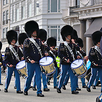 Marching Band towards Amalienborg in Copenhagen, Denmark<br /> When the Queen of Denmark is in residence, a marching band and the King's Guard accompany the Royal Life Guards in a procession that starts at 11:30 from the Rosenborg Castle and arrives at Amalienborg Slotsplads courtyard at noon. Their military march tunes ring through the Frederiksstaden District of Copenhagen.