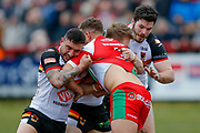 Bradford Bulls second row Elliot Minchella (12) tackles Keighley Cougars centre Hamish Barnes (3)  during the Betfred League 1 match between Keighley Cougars and Bradford Bulls at Cougar Park, Keighley, United Kingdom on 11 March 2018. Picture by Simon Davies.