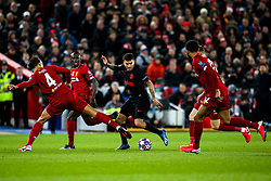 Angel Correa of Atletico Madrid goes past Virgil van Dijk of Liverpool - Mandatory by-line: Robbie Stephenson/JMP - 11/03/2020 - FOOTBALL - Anfield - Liverpool, England - Liverpool v Atletico Madrid - UEFA Champions League Round of 16, 2nd Leg