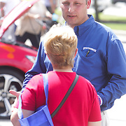 Ryan Adamczyk, right, talks to Lorraine Carilli Saturday September 13, 2014 at The Coastal Carolina Auto Show in Wilmington, N.C. (Jason A. Frizzelle)